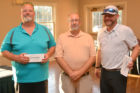 Net Score First Flight Winners: (L-R): William Boyer and Todd Shoemaker, two of the winning team members, accept their prize package from CEO Bob Rundle (center).